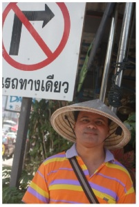Wearing my Asian conical hat in a Bangkok street.
